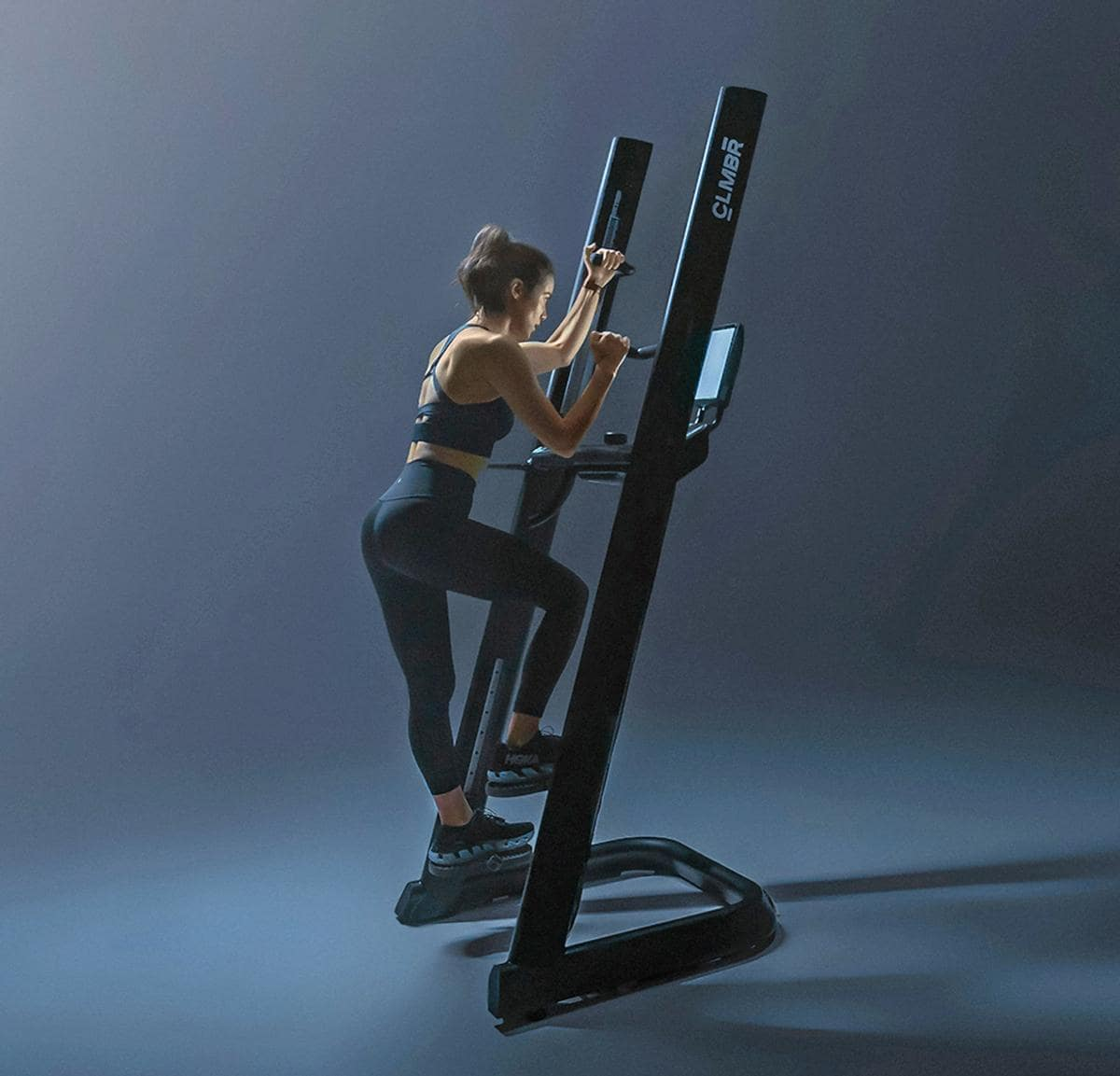 the sleek high-tech vertical climbing machine - CLMBR with display screen