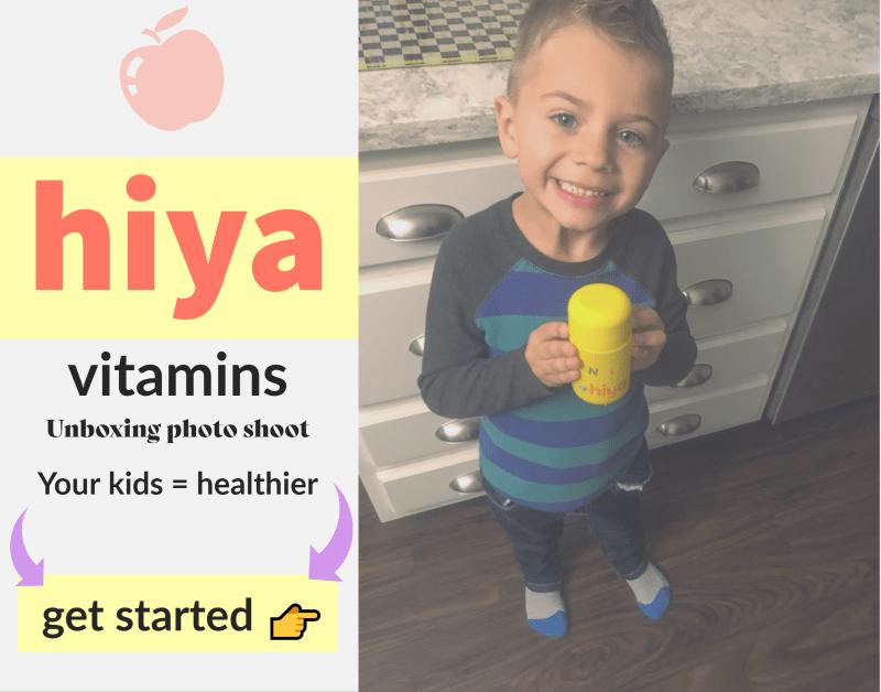 Tami's son Niko holding hiya health vitamins