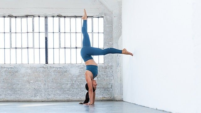 working on hand and headstand with alo moves workouts