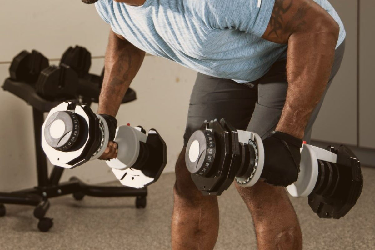 man does bent over dumbbell rows