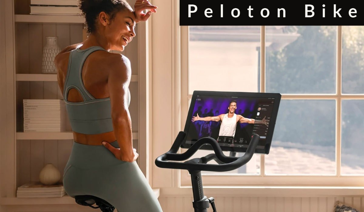 woman taking peloton's class on bike