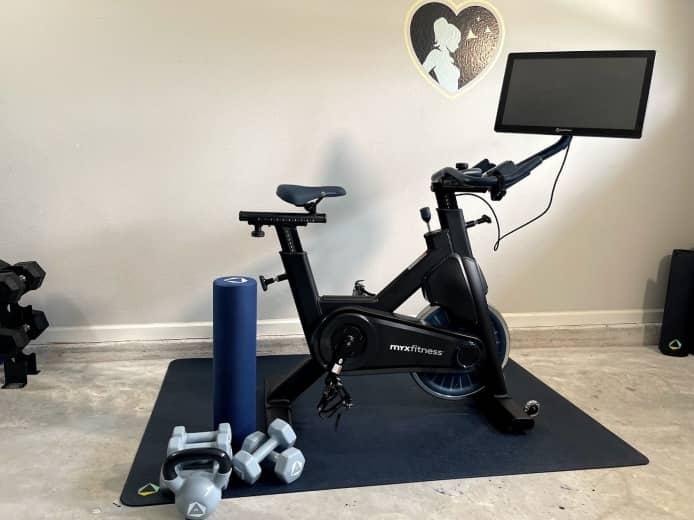the myx smart bike, mat, dumbbells, kettlebell and roller