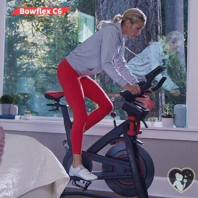 fit woman riding C6 spin bike by Bowflex