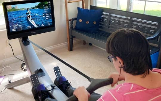 a beginner uses the hydrow smart rower