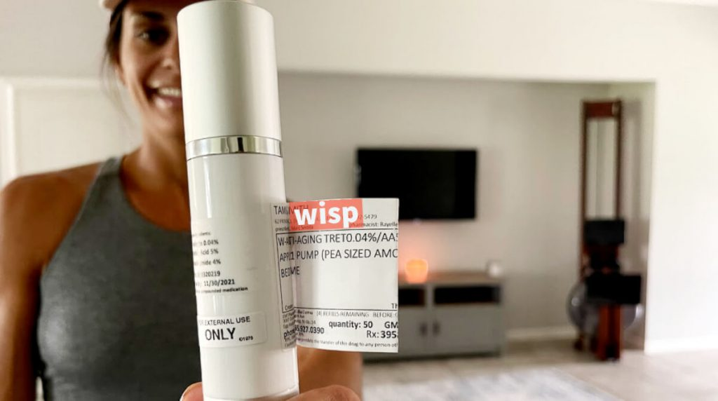 Tami Smith holding hello wisp skincare product