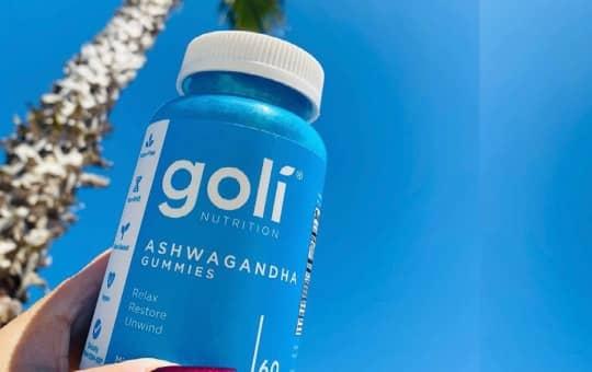 holding goli nutrition ashwa gummies bottle