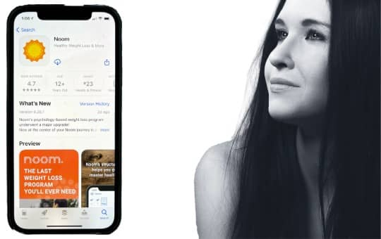 noom app and woman looking at it