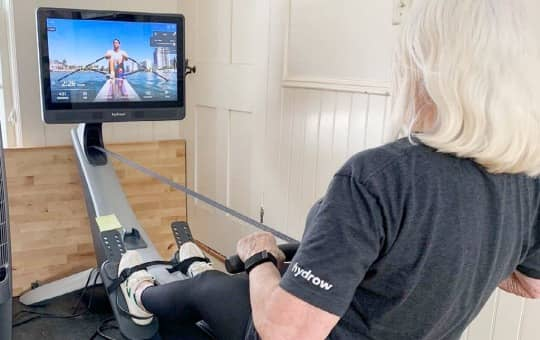 a beginner rowing on the hydrow and rating