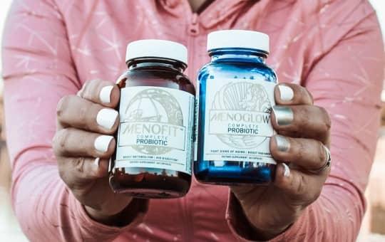 holding menofit bottle - verified