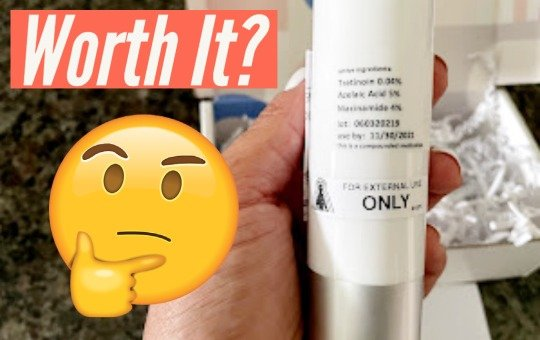 holding hellowisp skincare product with worth it text