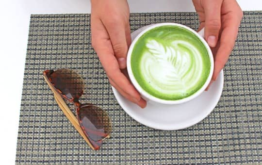 tenzo tea on table with sunglasses