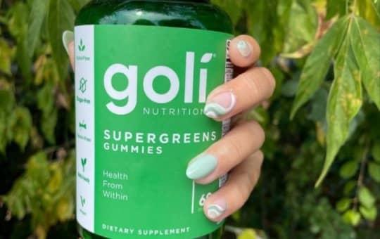 holding goli supergreens gummies and verifying