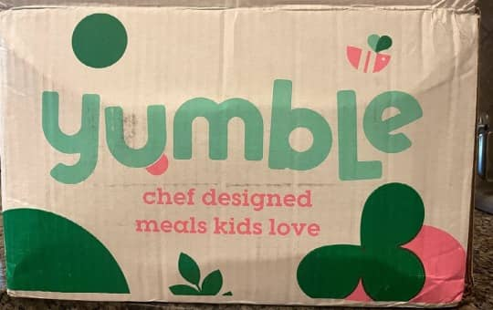 the yumble brand logo on delivery box