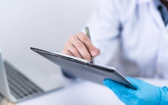 doctor writing prescription script